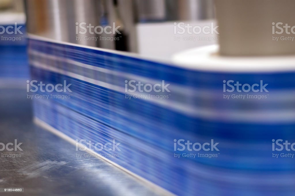 Labels being printed on a printing press.