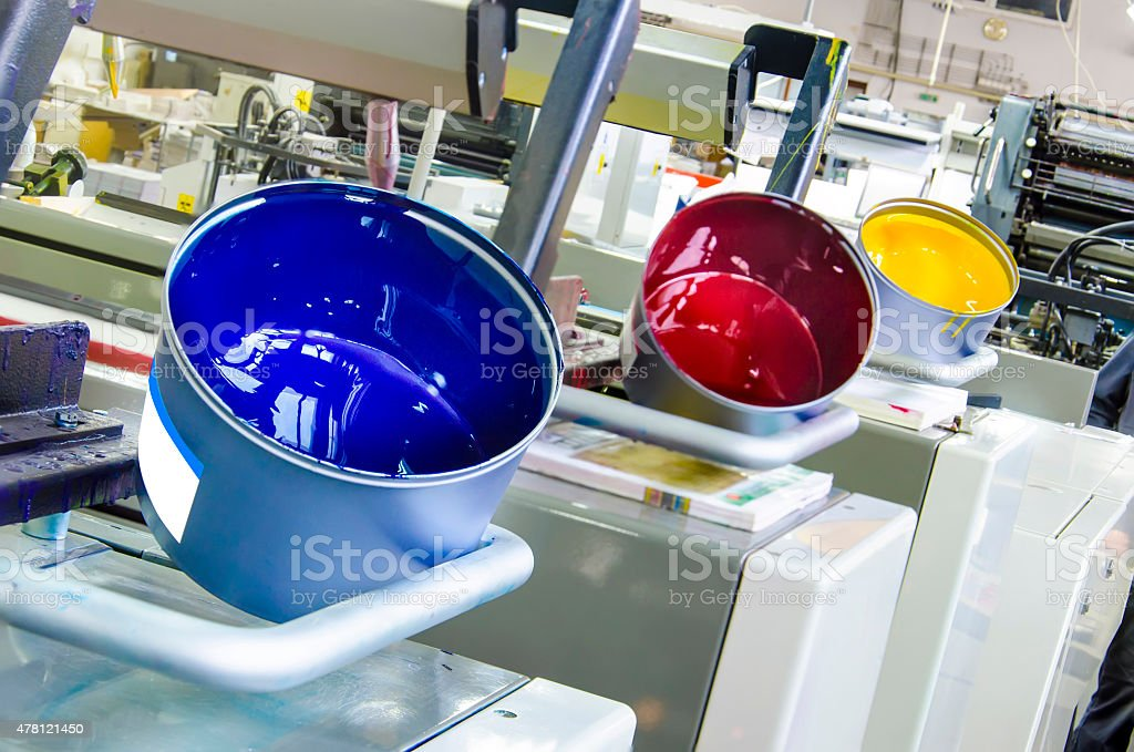 printing machine cylinders and printing ink pot with cyan red yellow...