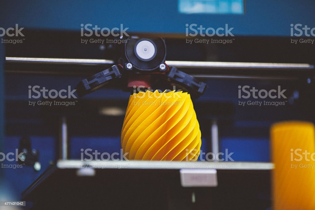 3D printing machine detail in action stock photo