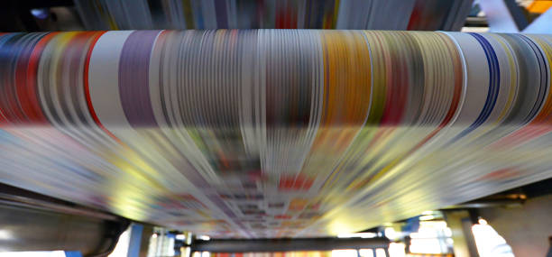 printing of coloured newspapers with an offset printing machine at a printing press - publication stock pictures, royalty-free photos & images