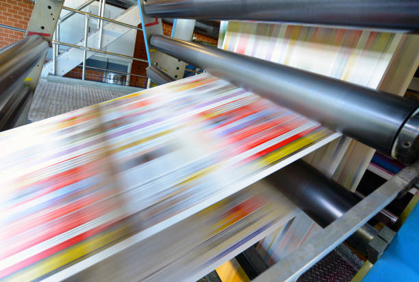 printing of coloured newspapers with an offset printing machine at a printing press printing of coloured newspapers with an offset printing machine at a printing press printing plant stock pictures, royalty-free photos & images