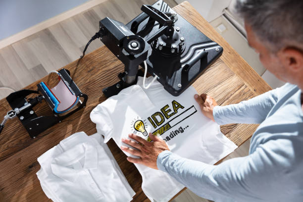 Printing On T-Shirt In Workshop stock photo