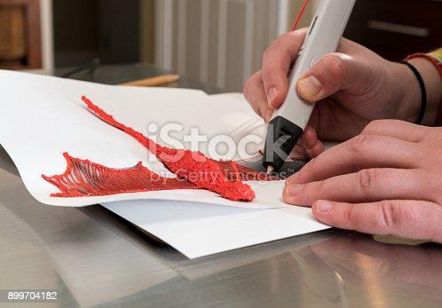 899701486 istock photo 3-D printing pen creating a dragon shape 899704182