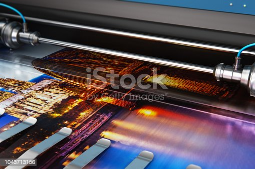 istock Printing photo banner on large format color plotter 1043713156