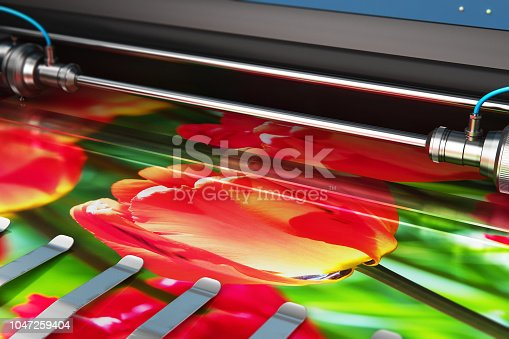 3D render illustration of printing photo banner on large format color plotter in typography or print house printshop