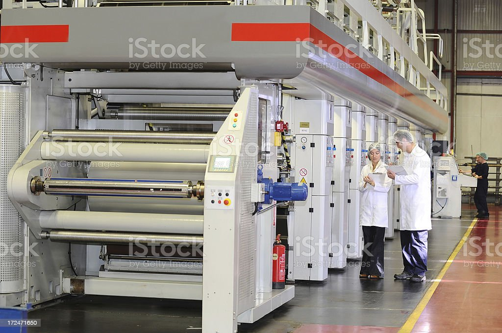 Printing press and quality control engineers stock photo
