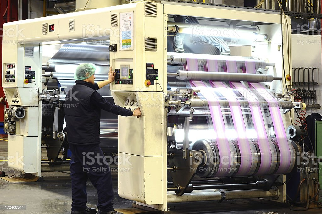 Printing press and worker royalty-free stock photo