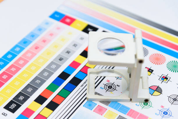 Printing Thread Counter checking registration stock photo