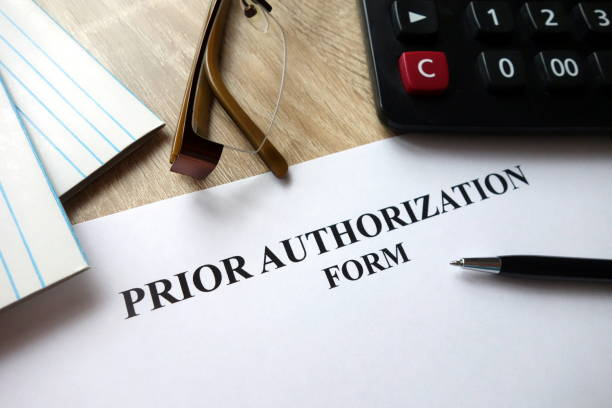 Prior authorization form Prior authorization form with pen, calculator and glasses on desk former stock pictures, royalty-free photos & images