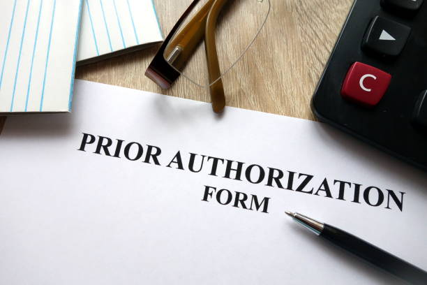 prior authorization form with pen, calculator and glasses - permit stock photos and pictures