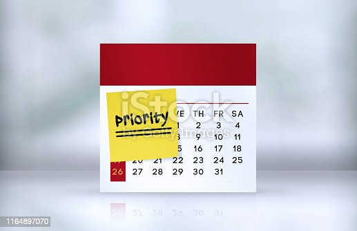 istock Priority Reminder Note Paper on The Desk Calendar 1164897070