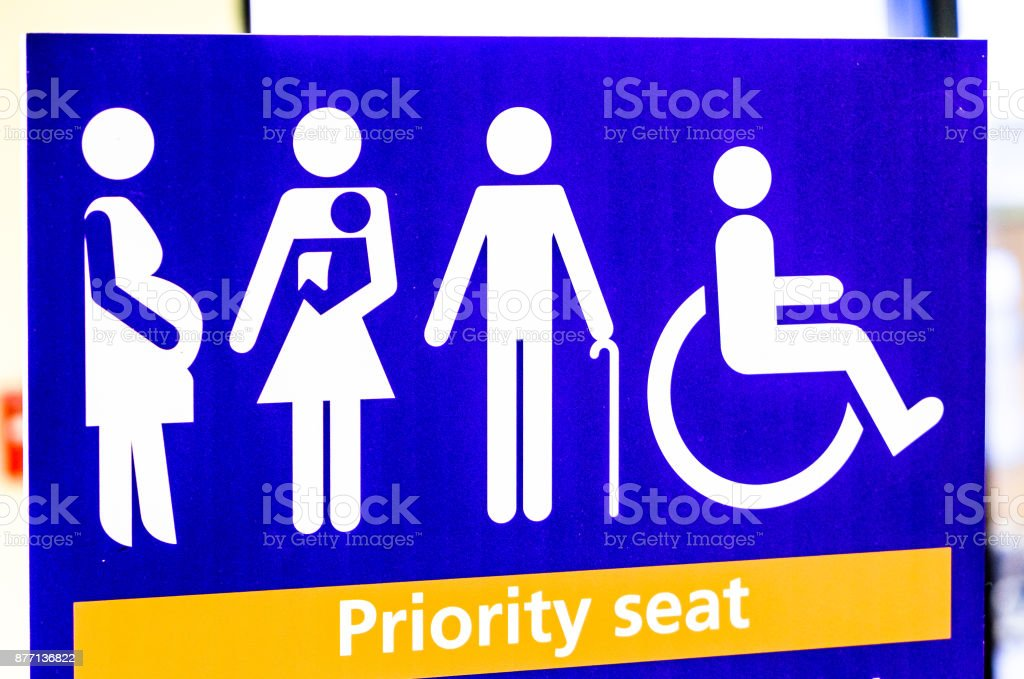 priority seat sign stock photo