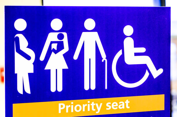 priority seat sign stock photo