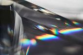 Prism dispersing sunlight splitting into a spectrum macro view
