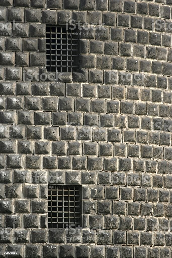 Prison bars in ancient castle royalty-free stock photo