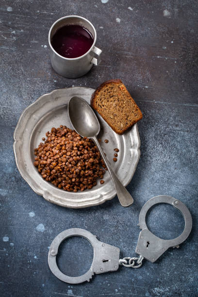 Cтоковое фото Prison food and handcuff above