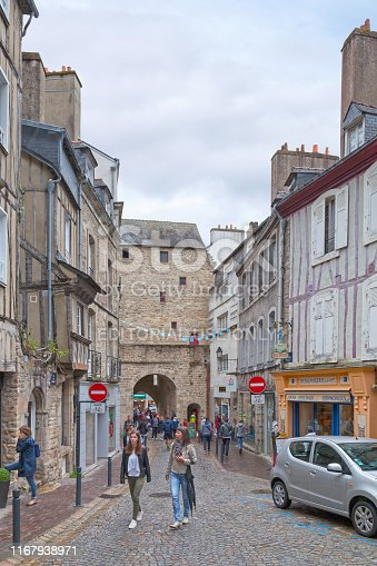 Vannes, France - July 26 2017: Street with half-timbered houses heading to the Porte Prison, the former prison gate of the city.