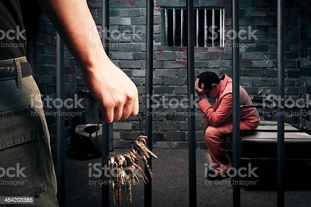A Prison Guard Holding A Large Bunch Of Keys Outside A Cell Stock Photo - Download Image Now