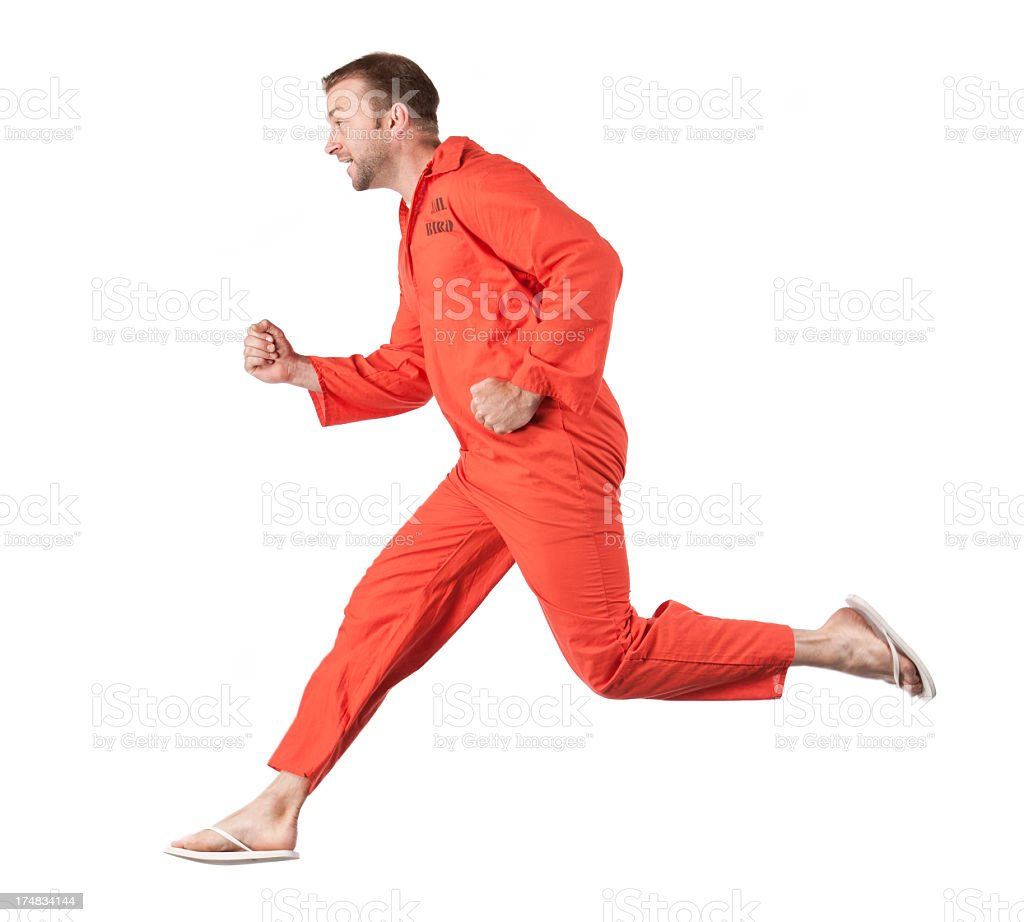 Prison Inmate Running Away stock photo