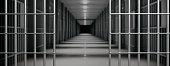 Prison interior. Jail bars open, empty corridor, cells, dark background. Escape, freedom concept, 3d illustration