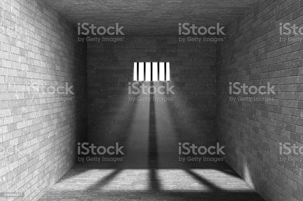 Prison interior with light shining through a barred window stock photo