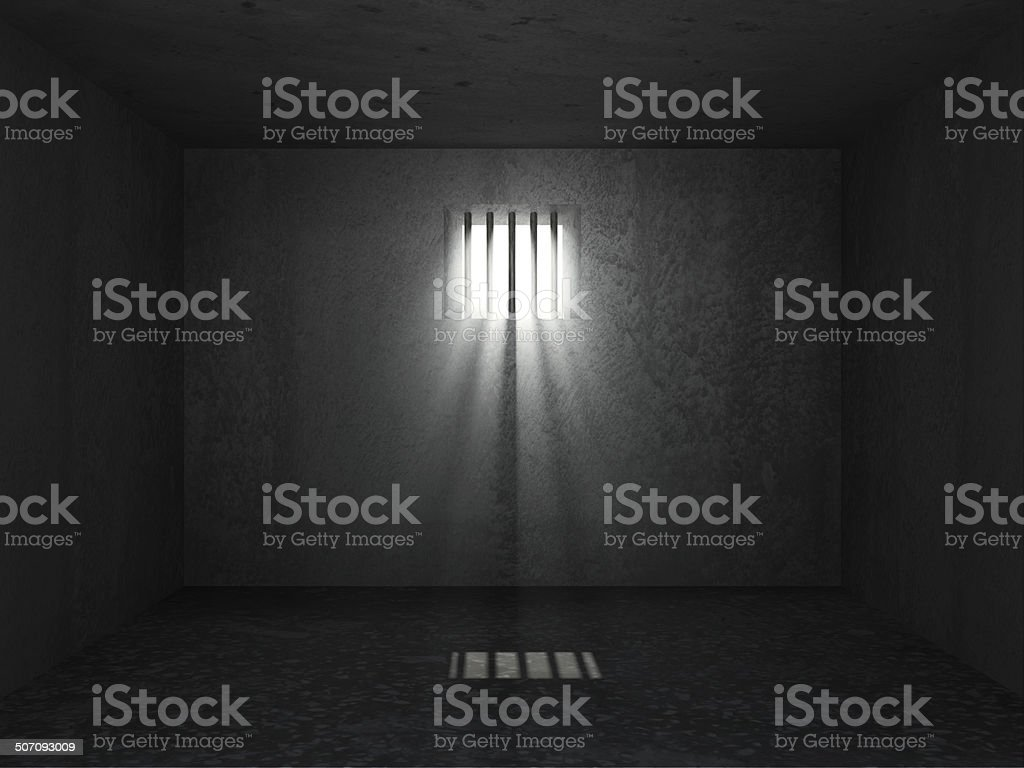 Prison Interior with sun rays breaking through a barred window stock photo