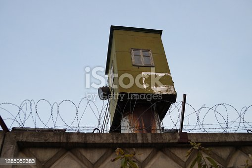 prison watchtower behind barbed wire in the zone close up