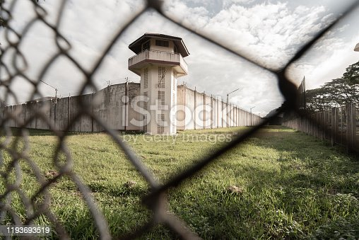 istock Prison with iron fences.Prison or jail is a building where people are forced to live if their freedom has been taken away.Prison is the building use for punishment prisoner. 1193693519