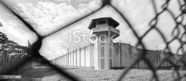 A prison with iron fences. Prison or jail is a building where people are forced to live if their freedom has been taken away. Prison is the building used for punishment prisoners.