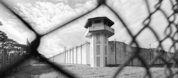 Prison with iron fences.Prison or jail is a building where people are forced to live if their freedom has been taken away.Prison is the building use for punishment prisoner. stock photo