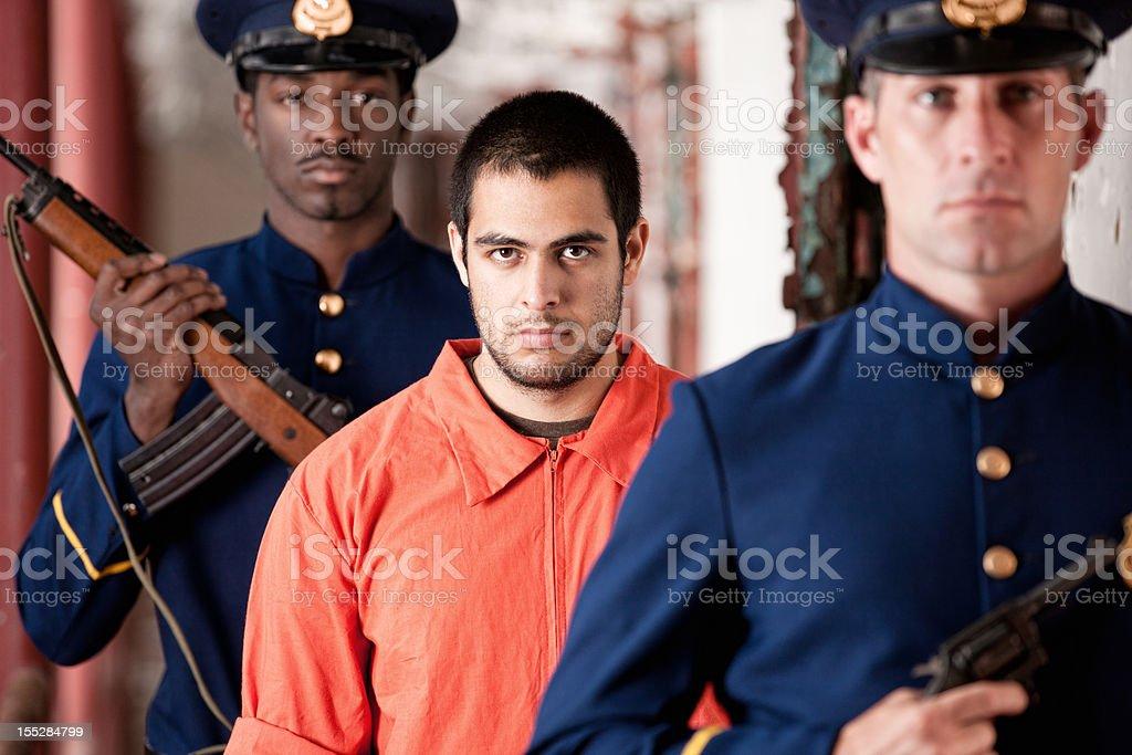 Prisoner Escorted By Prison Guards stock photo