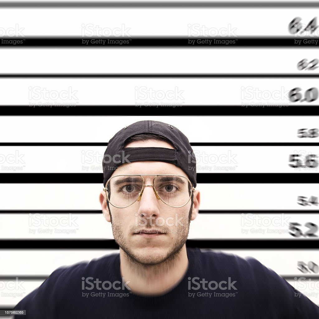 prisoner facing the wall for his photo identification royalty-free stock photo