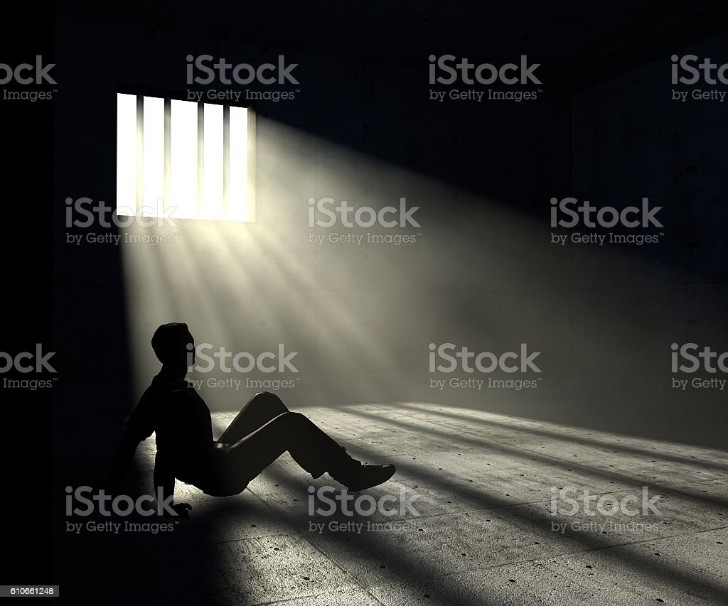 prisoner in dark room with light beams stock photo