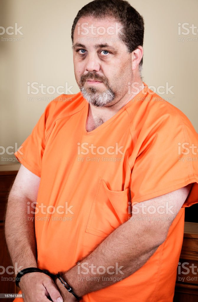 Prisoner in Handcuffs stock photo