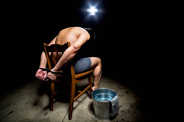 Prisoner Tortured with Waterboarding stock photo