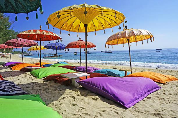 pristine beach bathed by the bali sea - bali stockfoto's en -beelden