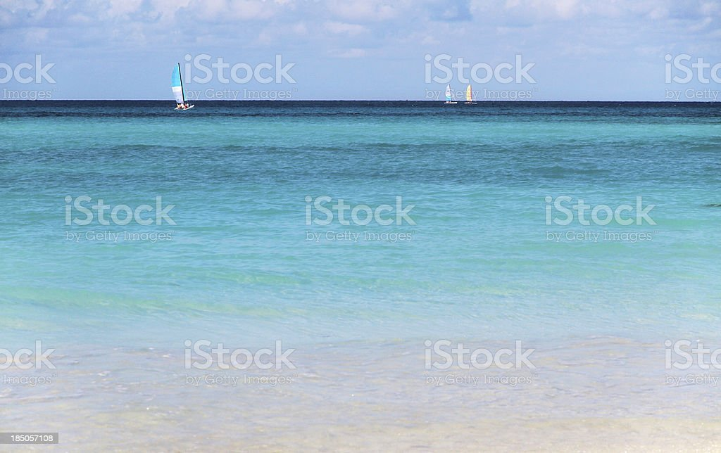 Pristine Tropical Beach with Sailboats royalty-free stock photo