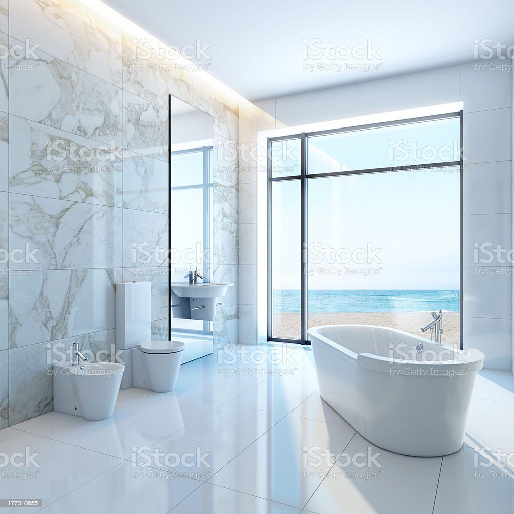 Pristine white bathroom by the sea stock photo