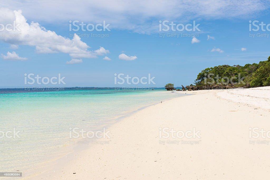 Pristine white tropical beach with blue sea in Pemba stock photo