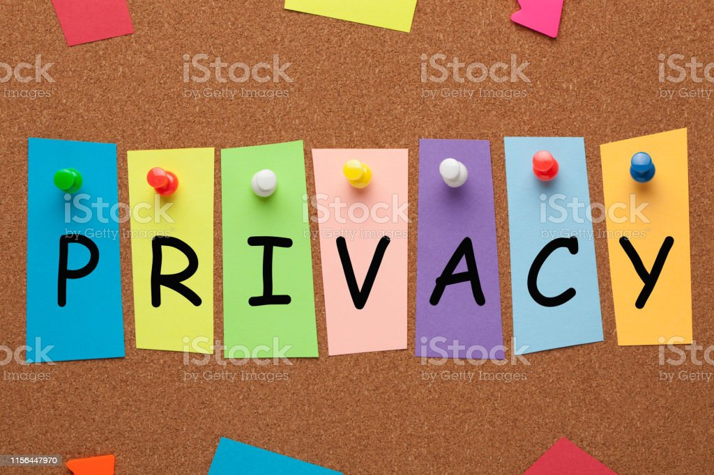 The word Privacy written in colorful stickers pinned on cork board....