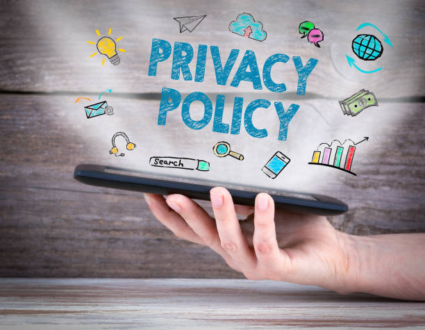 privacy policy. tablet computer in the hand. old wooden background - privacy policy stock photos and pictures