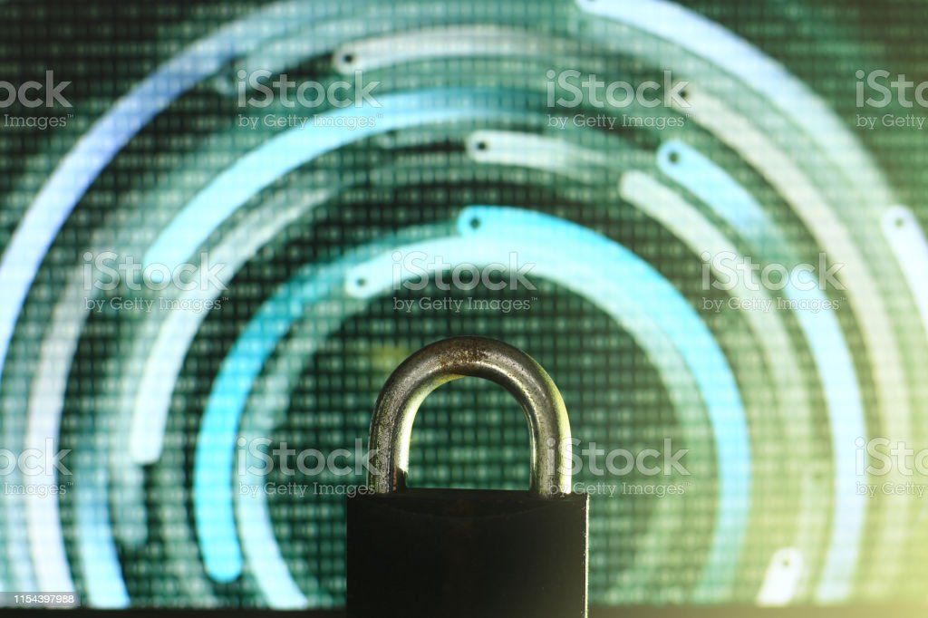 closed padlock in front of green matrix and circular lines...