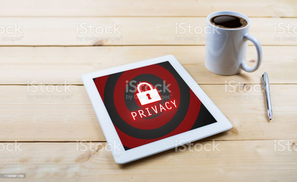 Privacy text with lock icon on tablet on wooden desk