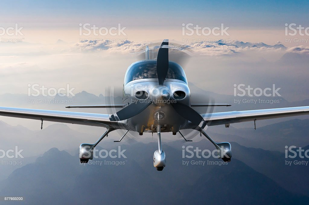 Privat plane or aircraft flight surrounded by mountains and rocks stock photo