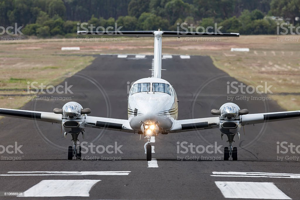 Private aircraft head on down the runway stock photo