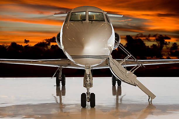 Private airplane at sunset stock photo