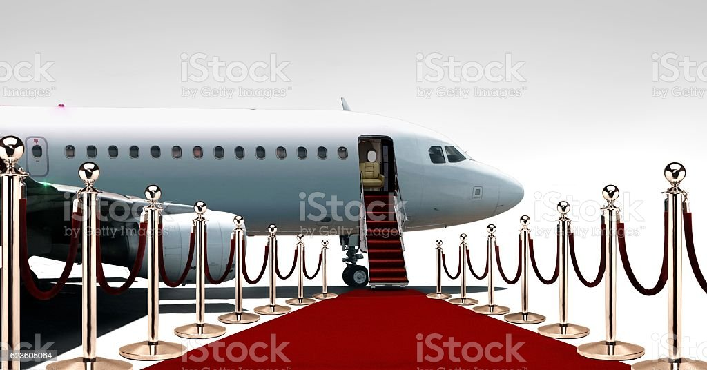 Private airplane boarding on red carpet stock photo