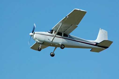 private airplane Cessna 182 flying in clear blue sky