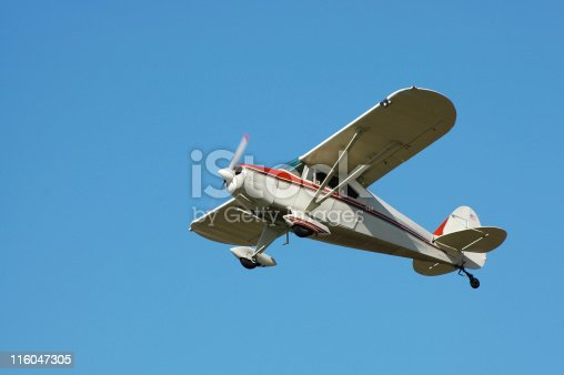 Small private airplane against blue sky. Built in the 1940s. Fairchild M-62A.