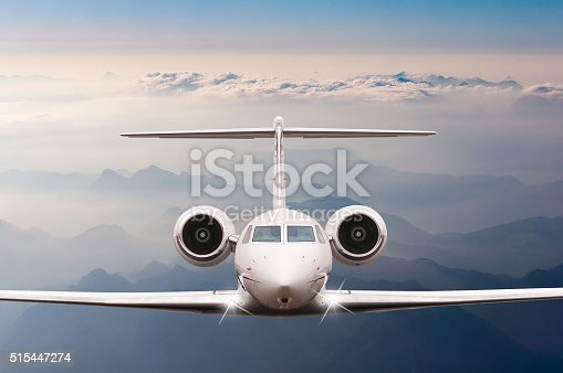 istock Private Airplane fly over clouds and Alps mountain on sunset 515447274